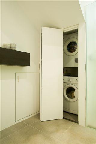 custom joinery hidden laundry in bathroom