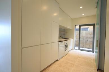custom joinery white laundry